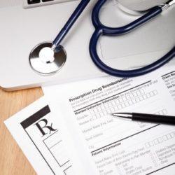 stethoscope laptop medical records